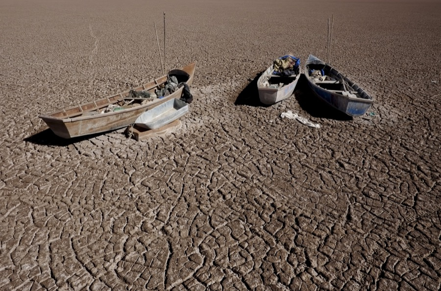 Fishing boats on the dried Poopó lakebed in the Oruro Department, south of La Paz, Bolivia, on Dec. 17, 2015.