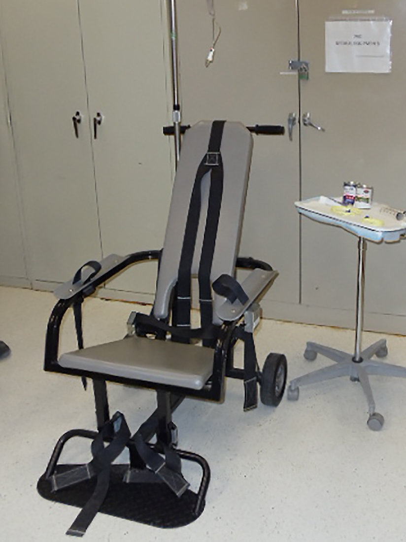 A restraint chair and other equipment of the type used in force-feeding detainees displayed during a media tour of the Guantánamo Bay military prison on April 19.