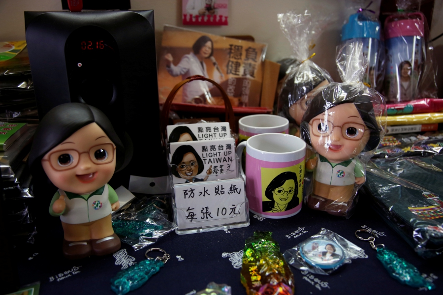 Rubber toys and knick-knacks featuring a cartoon woman with glasses