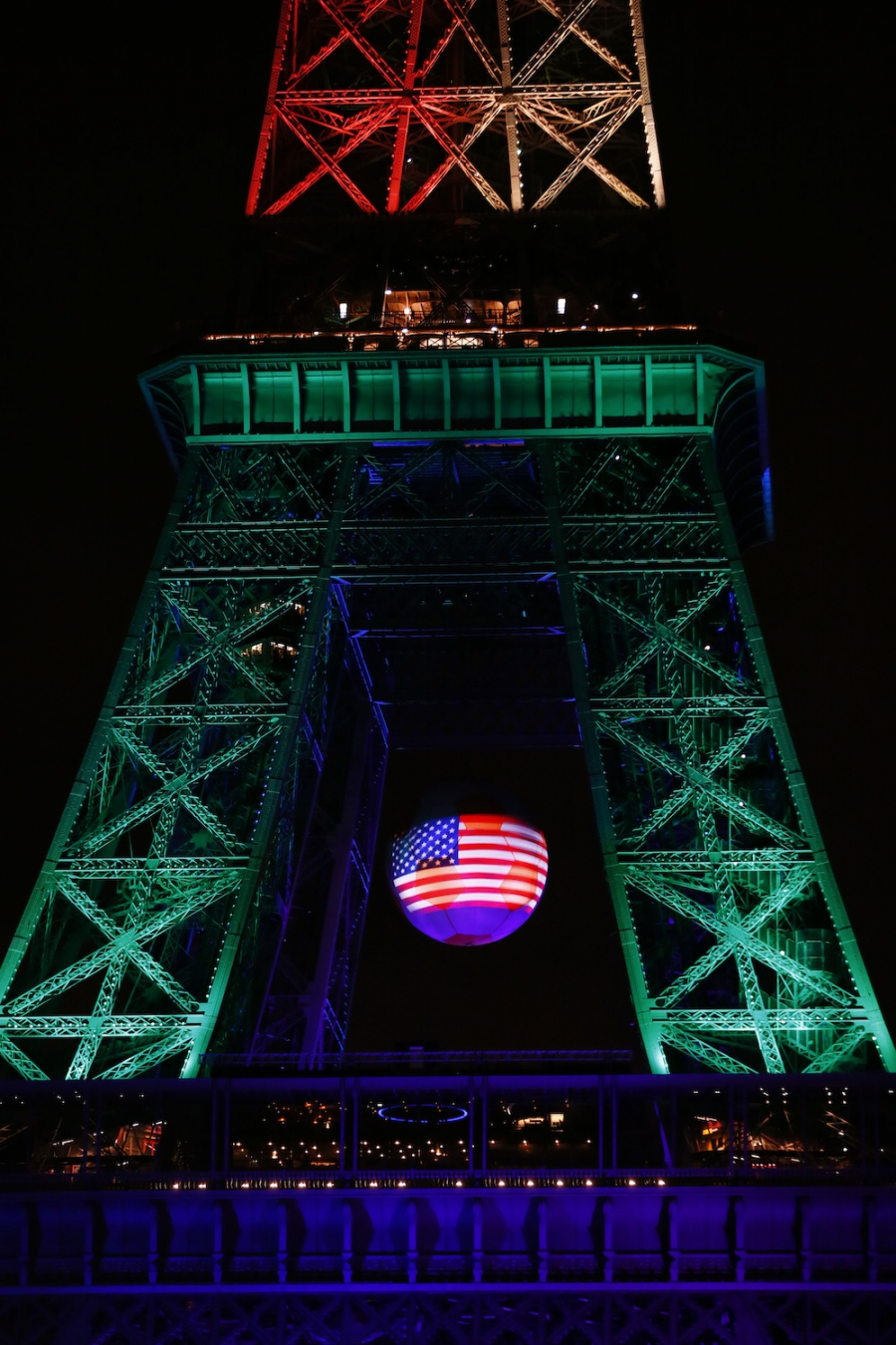 The American flag is projected onto the Eiffel Tower illuminated in memory of the victims of the nightclub mass shooting in Orlando on June 13.