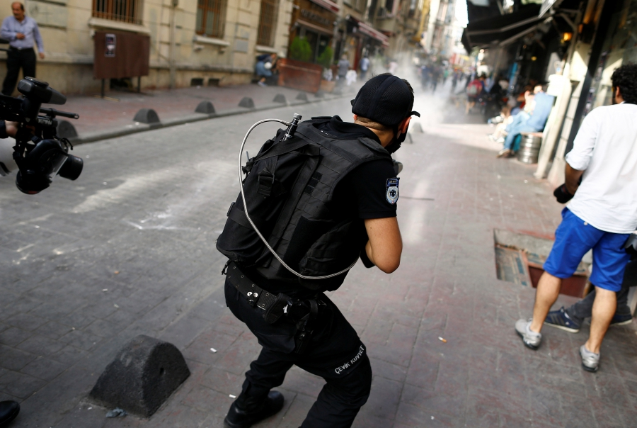 Riot police use rubber pellets to disperse LGBT rights activists during a transgender pride parade, which was banned by the governorship, in central Istanbul, Turkey, June 19, 2016.