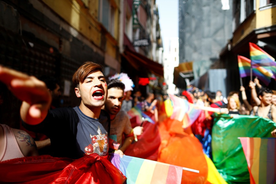 LGBT rights activists hold a rainbow flag during a transgender pride parade that was banned by the authorities in Istanbul on June 19.