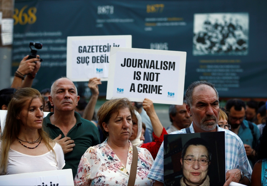 Demonstrators shout slogans during a protest against the arrest of three prominent activists for press freedom, in central Istanbul, Turkey, June 21, 2016.