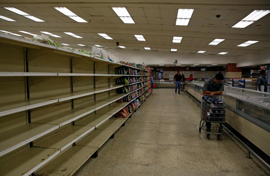 People buy food and other staple goods inside a supermarket in Caracas, Venezuela June 30, 2016.