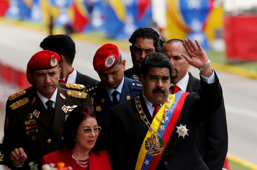 Venezuela's President Nicolas Maduro waves to the media next to his wife Cilia Flores after the military parade to celebrate the 205th anniversary of Venezuela's independence in Caracas, Venezuela July 5, 2016.
