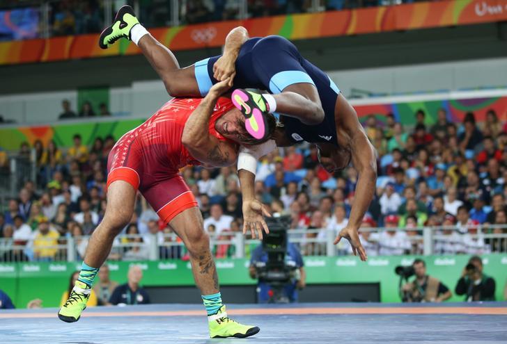 Wrestlers Frank Molinaro (USA) of USA and Frank Chamizo Marquez (ITA) of Italy compete at the 2016 Rio Olympics, Rio de Janeiro, Brazil.