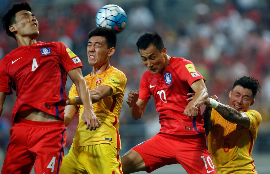 Li Xuepeng of China and Ji Dong-won of South Korea in action at the World Cup 2018 Qualifiers in Seoul, South Korea.