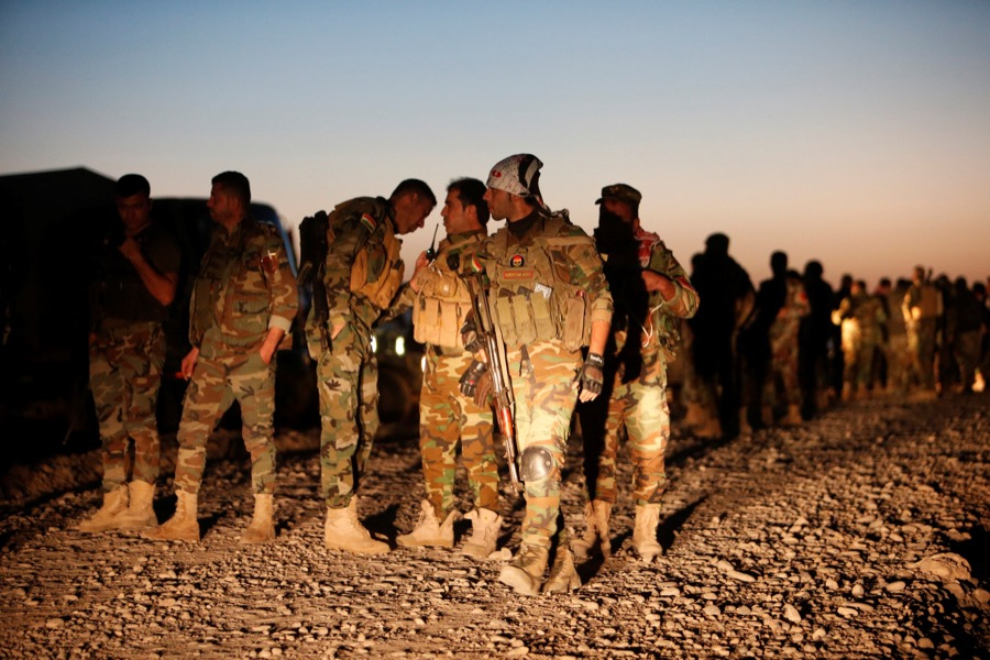 Peshmerga forces gather in the east of Mosul to attack Islamic State militants in Mosul, Iraq, on Oct. 17.