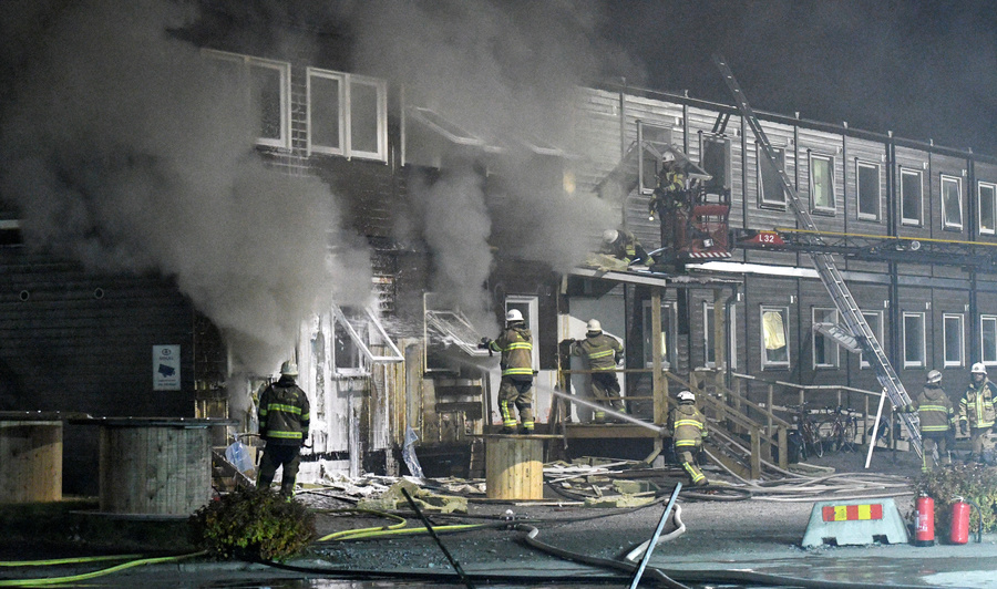 Firefighters extinguish a fire that broke out at a refugee center in Fagersjo, south of Stockholm, Sweden on the night of Oct. 16, 2016. Police suspected arson was the cause.