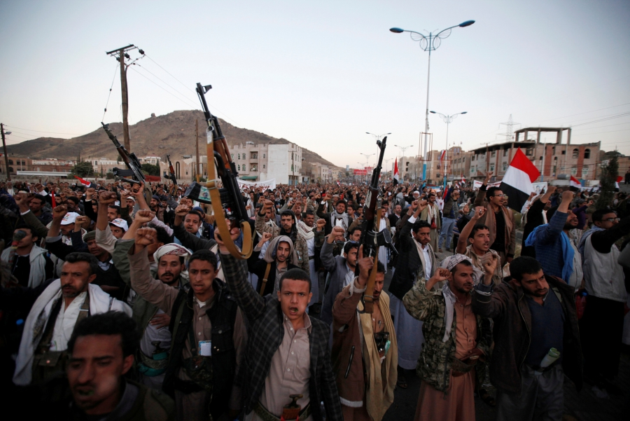Followers of the Shi'ite Houthi movement shout slogans as they attend a rally