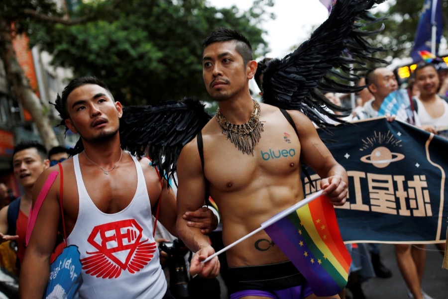 A participant holds a rainbow flag as he takes part in the lesbian, gay, bisexual and transgender pride parade in Taipei, Taiwan on Oct. 29.