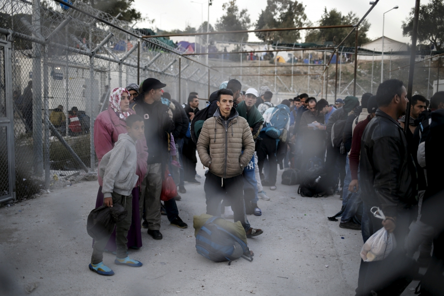Refugees and migrants wait to be registered at the Moria refugee camp on the Greek island of Lesbos, November 5, 2015.