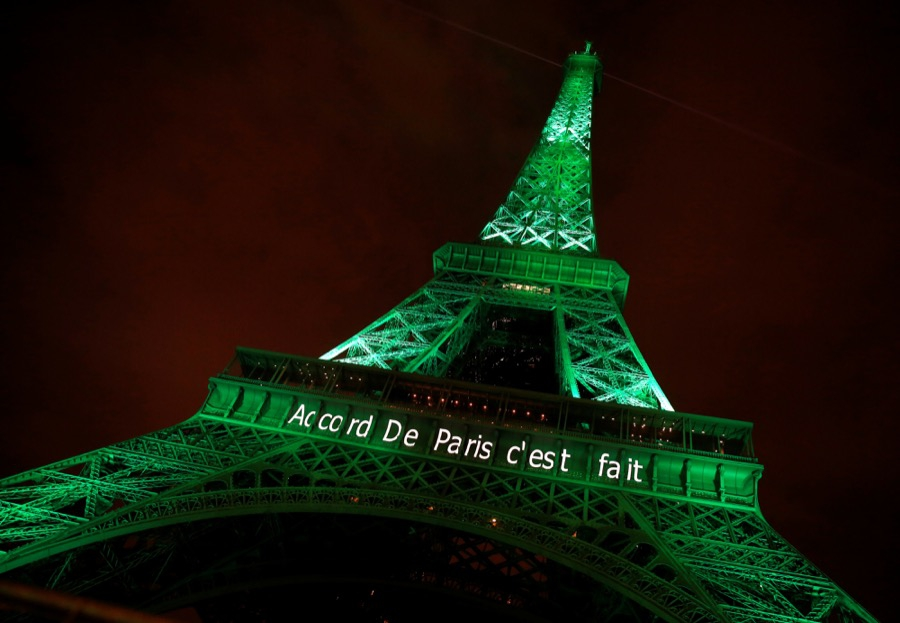 "The Eiffel Tower is lit up green with the words ""Paris Agreement is Done"" to mark the Paris climate agreement on Nov. 4."