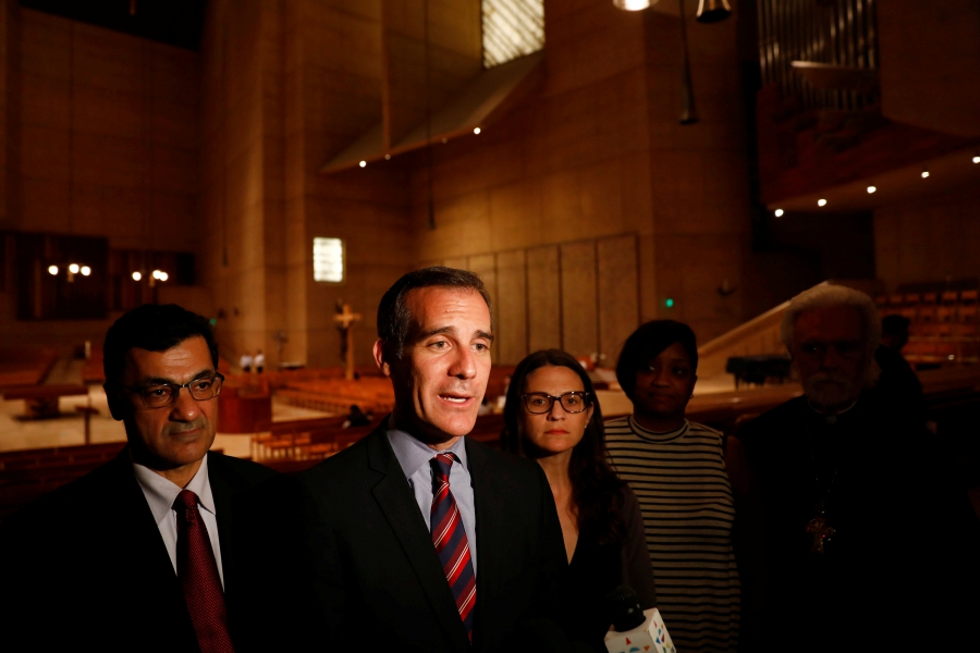 Los Angeles Mayor Eric Garcetti speaks on November 10, 2015 after an interfaith prayer service for the immigrant community following the election of Republican Donald Trump as president. He has created a legal defense fund to give lawyers to immigrants facing deportation. (Patrick T. Fallon/Reuters)