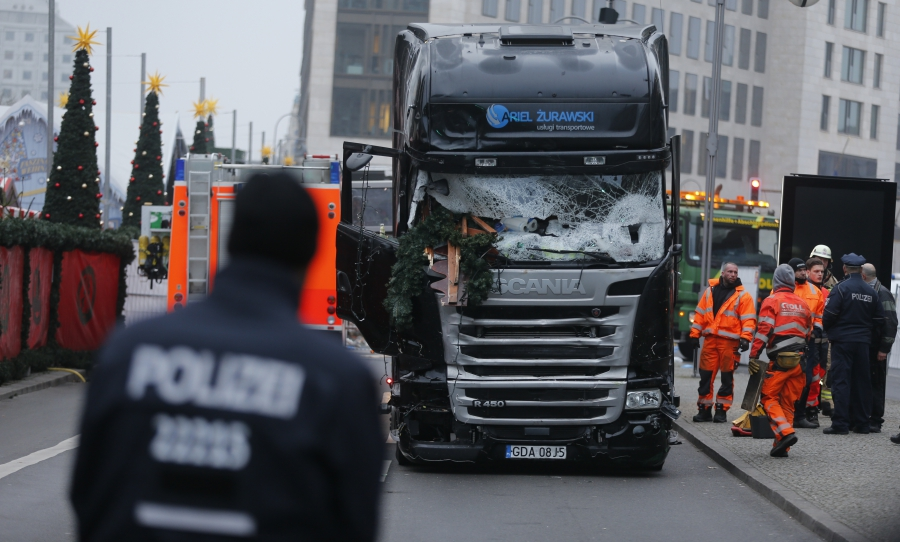 Police stand in front of the truck which ploughed last night into a crowded Christmas market in the German capital Berlin, Germany, December 20, 2016.