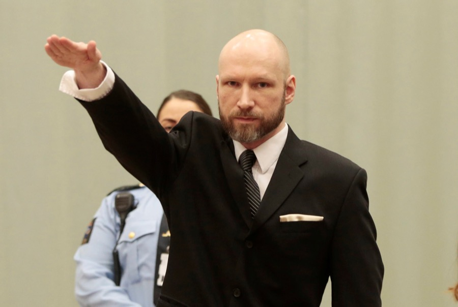 Anders Breivik raises his right hand during the appeal case in Borgarting Court of Appeal at Telemark prison in Skien, Norway