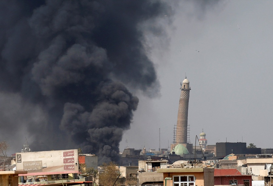 Smoke rises from clashes on March 17 near Mosul's al-Habda minaret at the Grand Mosque, where ISIS leader Abu Bakr al-Baghdadi declared his caliphate back in 2014.