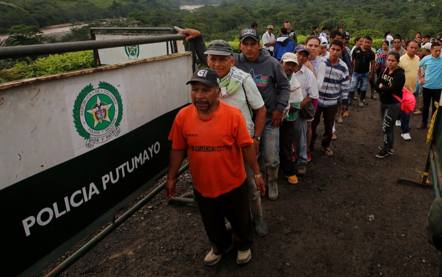 People wait to recognize the bodies of their relatives in the cemetery in Mocoa, Colombia on April 2.