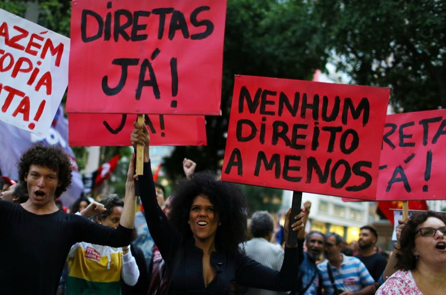 Demonstrators attend a protest against Brazil's President Michel Temer in Rio de Janeiro