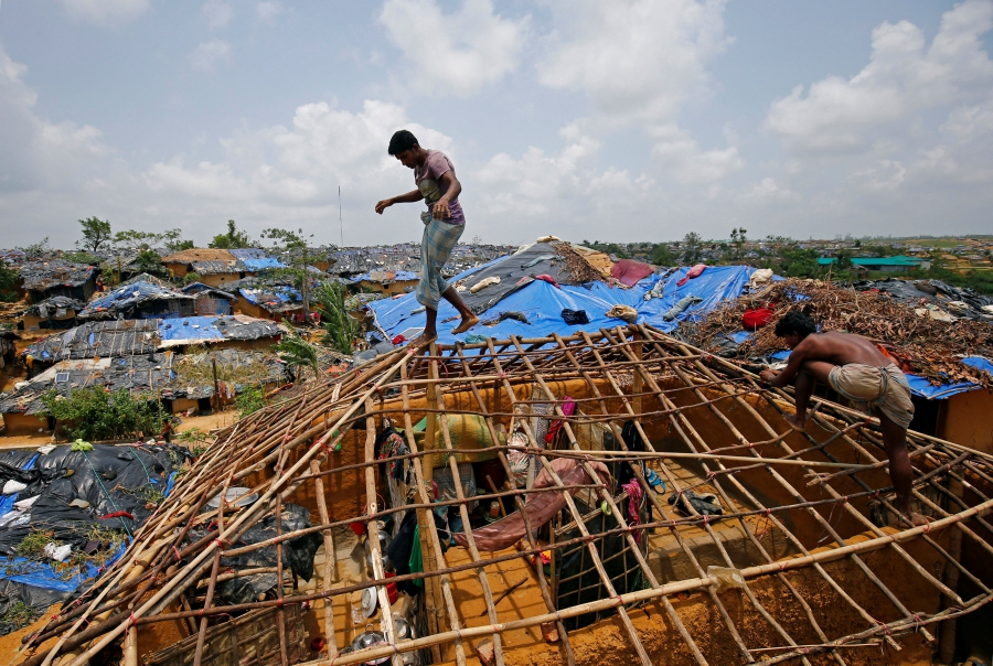 Rohingya refugees rebuild their home, which was destroyed by Cyclone Mora, at the Kutupalong makeshift refugee camp in Cox's Bazar, Bangladesh, June 1, 2017.