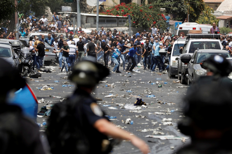 Palestinians clash with Israeli security forces outside Jerusalem's Old city.