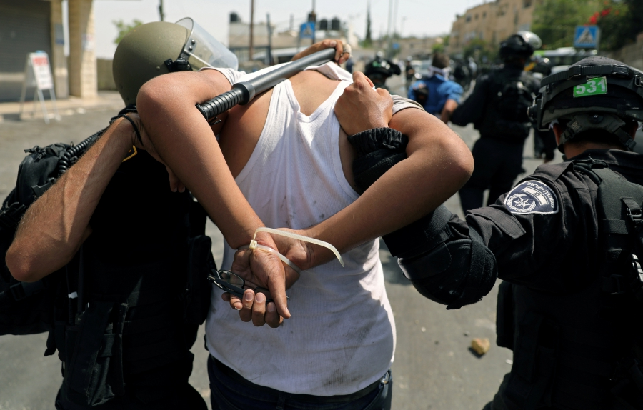 Israeli security forces arrest a Palestinian man following clashes outside Jerusalem's Old city.