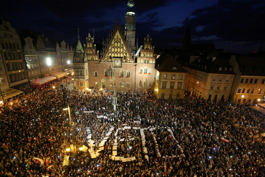People attend a protest against supreme court legislation in Wroclaw, Poland