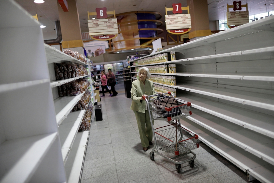Amid a food shortage, people shop inside a supermarket in Caracas, Venezuela, July 25, 2017.
