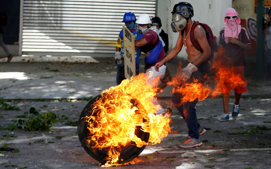 Demonstrators rally during a strike called to protest against Venezuelan President Nicolas Maduro's government in Caracas, Venezuela, July 26, 2017.