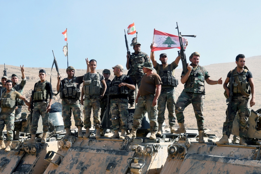 Lebanese army soldiers flash the victory sign in Ras Baalbek, Lebanon, on Aug. 28, 2017.