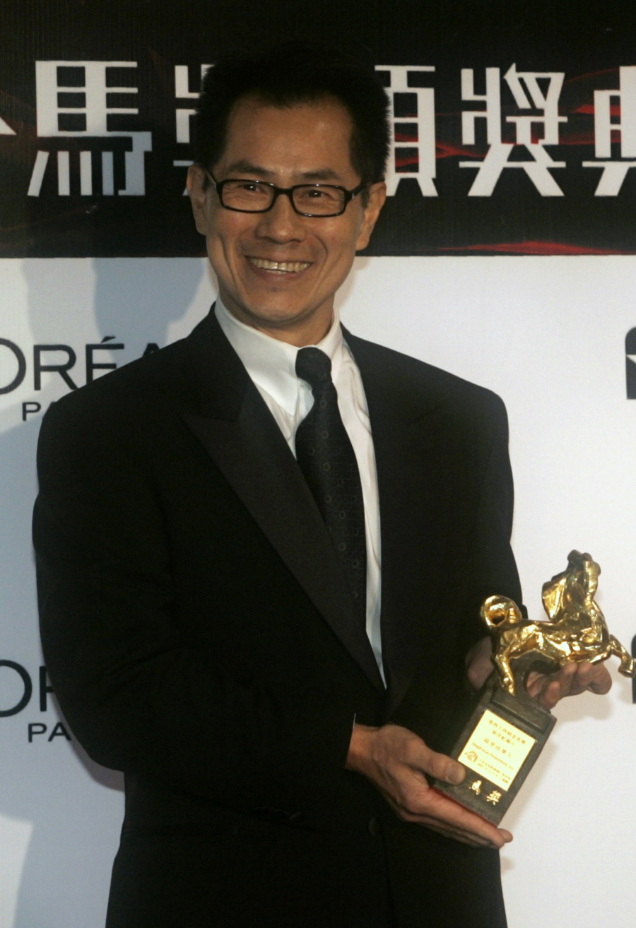Director Arthur Dong poses with the award