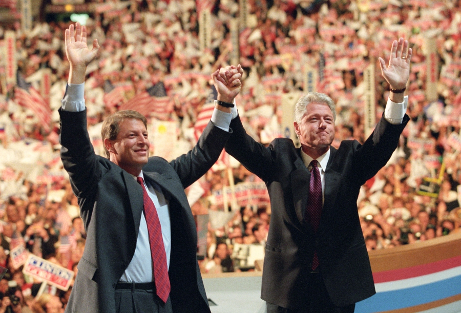 Al Gore and Bill Clinton in convention hall waving