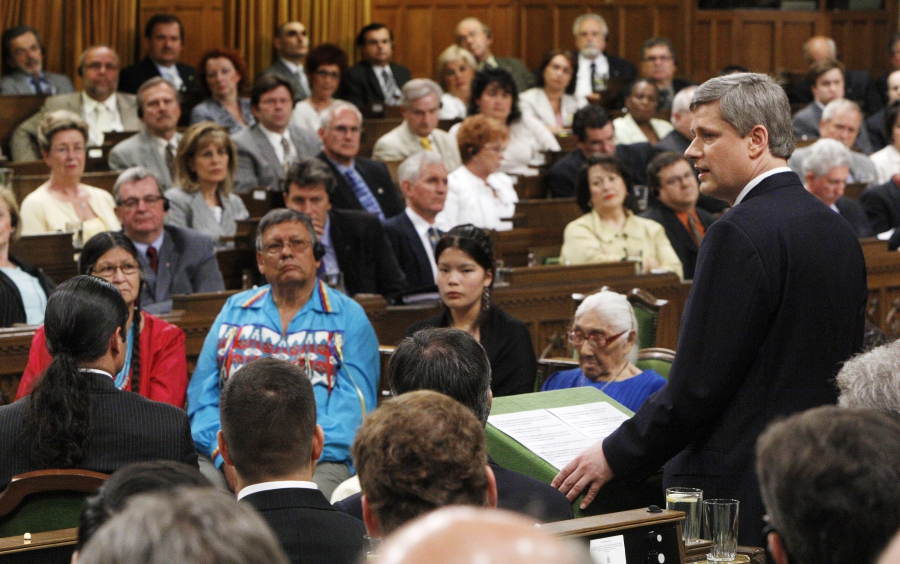 Canada's Prime Minister Stephen Harper issues an apology in the House of Commons on Parliament Hill in Ottawa June 11, 2008.