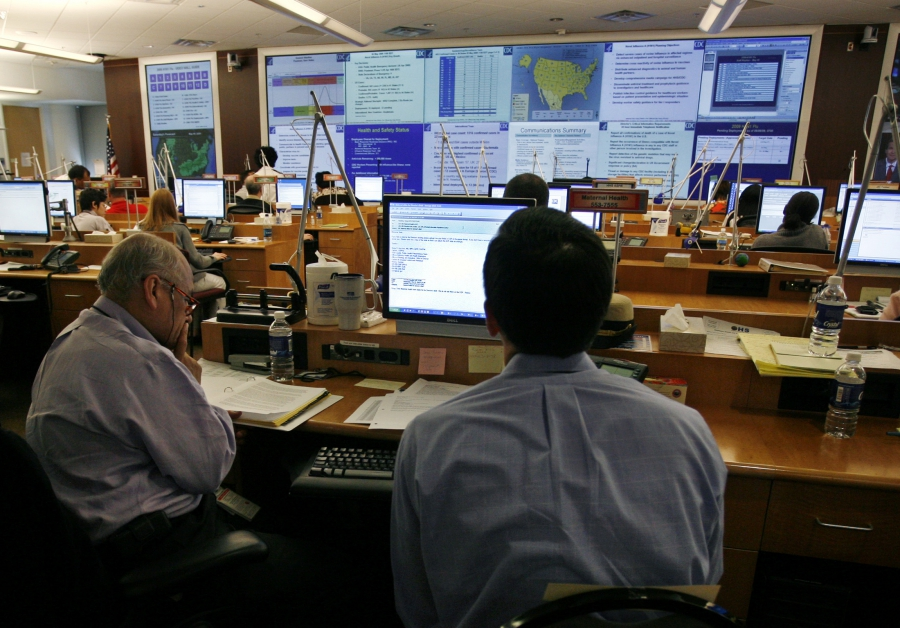 Centers for Disease Control workers monitor the H1N1 flu virus outbreak from the CDC Emergency Operations Center in Atlanta, Georgia May 6, 2009.