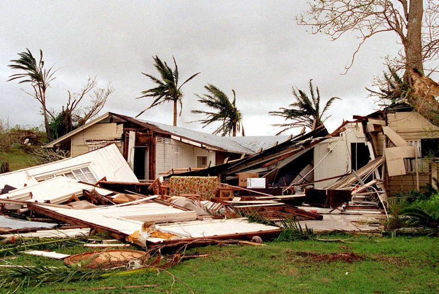 Houses in Nimitz Hill near Naval Station Marianas, Guam, were crumpled by Typhoon Paka