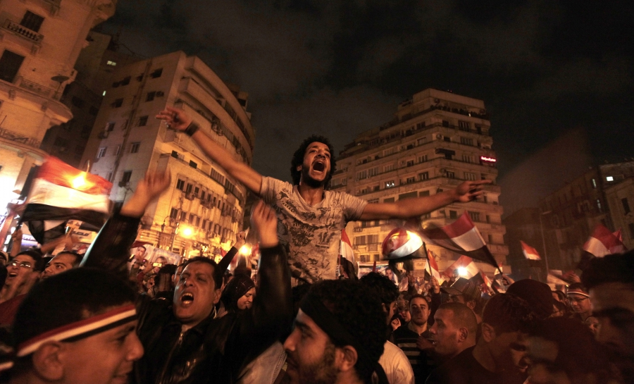 Anti-government protesters celebrate in Tahrir Square after the announcement of Egyptian President Hosni Mubarak's resignation in Cairo, Feb. 11, 2011.