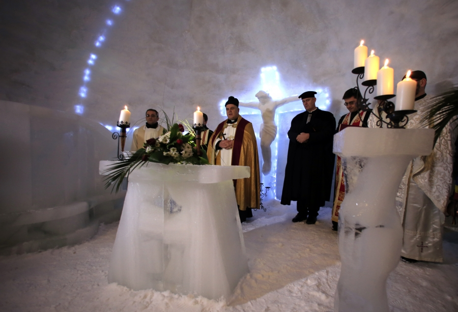 A group of priests of various congregations hold an inaugural mass for a church made entirely from ice at Balea Lac resort.