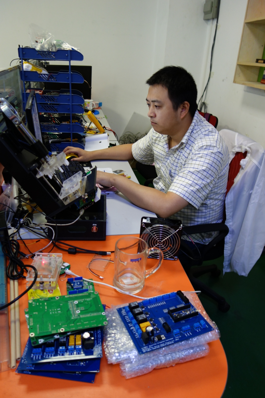 At work at SEEED Studio, which offers open-source hardware for makers