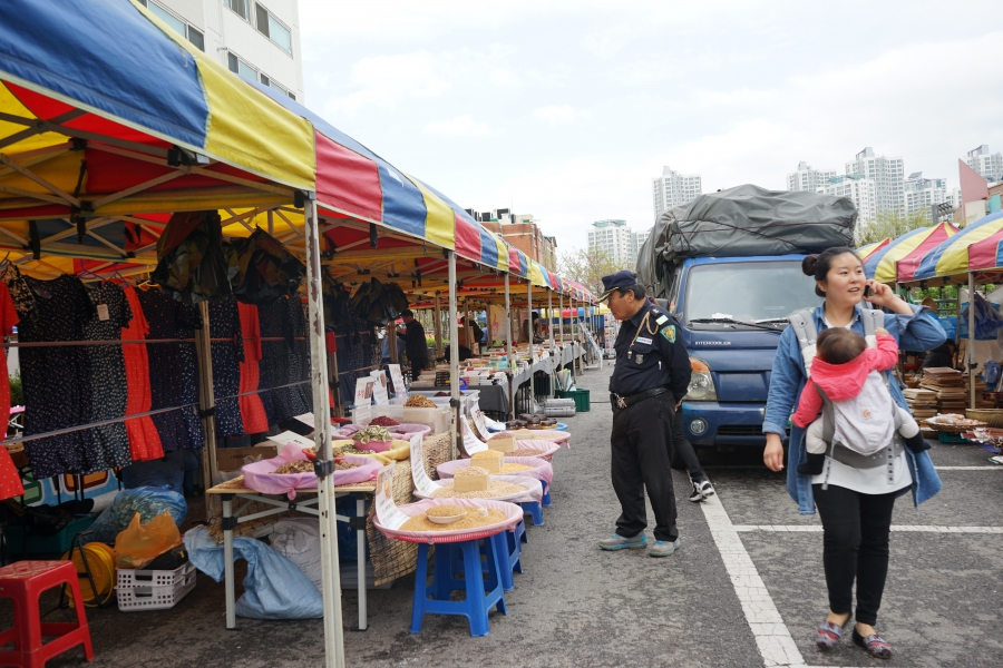 A police officer browses a South Korean market.  Danbi says many of the goods sold here can also be found in North Korean markets.