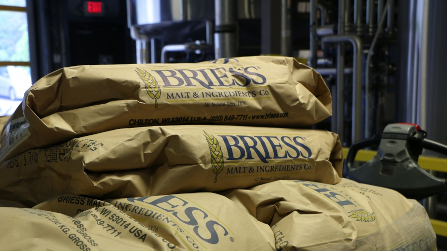 Bags of malt await their introduction to the beer-making pipeline at the Magic Hat brewery in Burlington, Vermont. Purpose Energy, a former Greentown firm, is using its new technology to turn much of the waste that comes out of the other end of the pipe i
