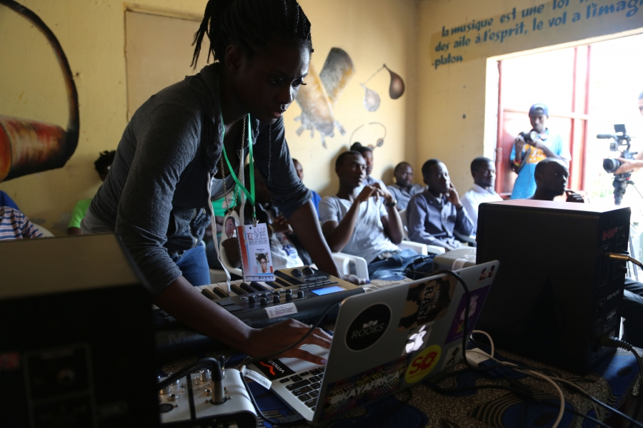 Beat making session in Goma with rapper Sammus