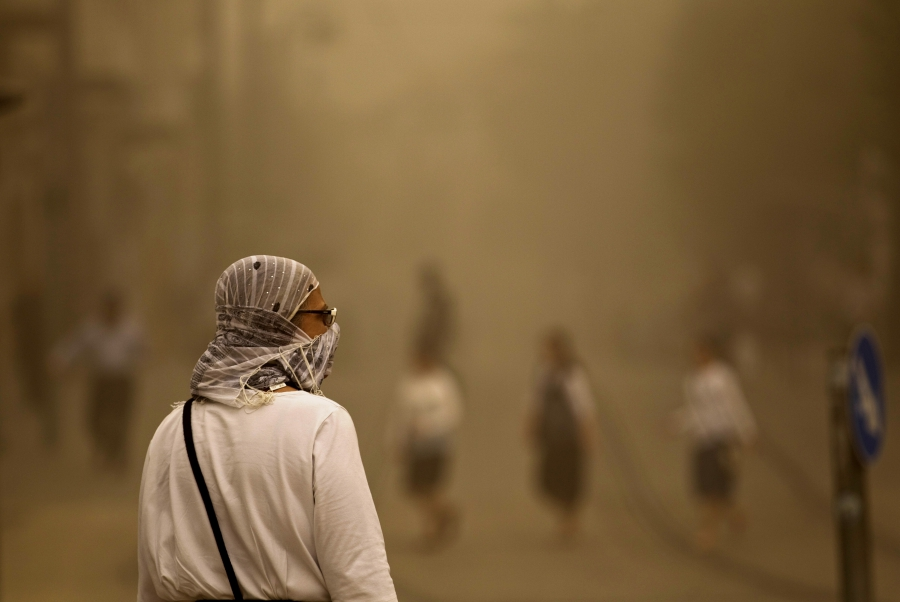 A pedestrian walks with a covered face during a sandstorm in Jerusalem September 8. Clouds of dust have engulfed Israel, Jordan and Cyprus.
