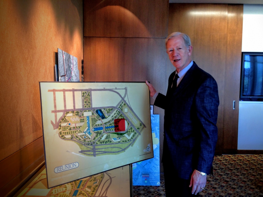 John Scovell, President and CEO of Woodbine Development Corporation in Dallas, shows off the original plan for the parcel of land he named after the La Réunion colony.