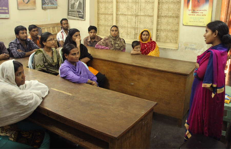 Shamima Akter, an organizer with the Bangladesh Garment and Industrial Workers Federation, talks to workers about intimidation.