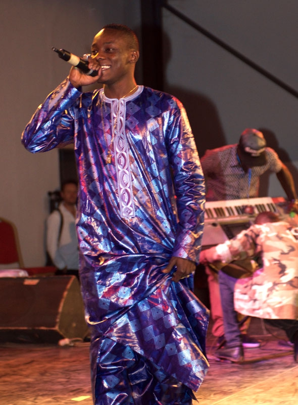 """Sidiki Diabaté is a huge pop star — """"more popular than me!"""" says his father and festival organizer Toumani. Sidiki headlined a 4,000-seat sports center packed with teenagers swooning and screaming for his pop rap. When he hit the stage at around 3 am, the"""