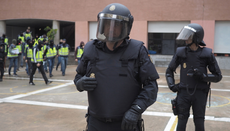 Spanish police arrive at a Barcelona school where Catalan independence voting was taking place.