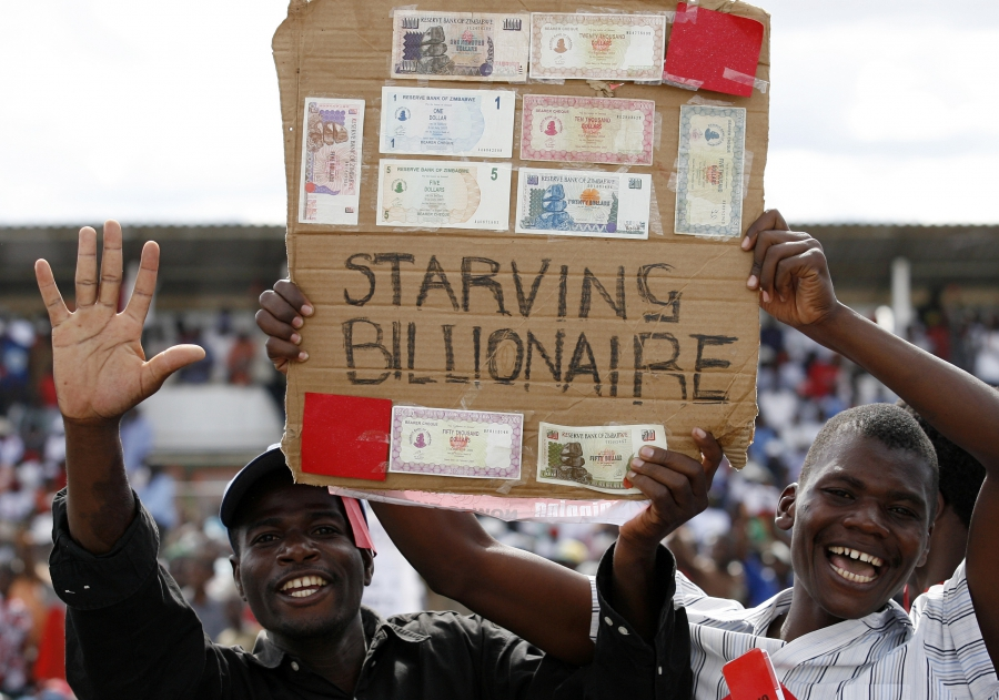 Zimbabwe protesters show old worthless bank notes near the capital Harare, 2008.