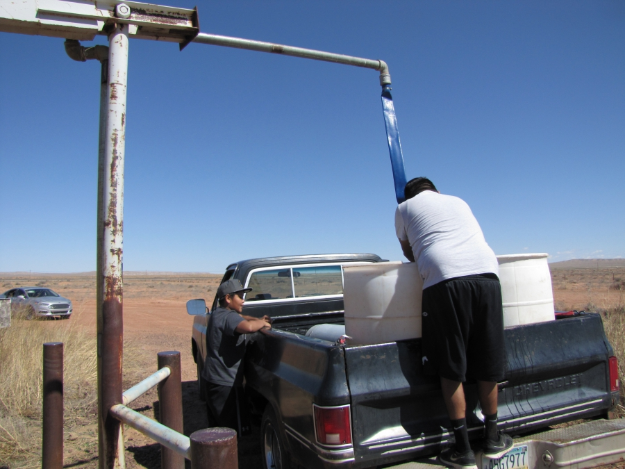 Sterling and Brennan Begay fill up water barrels for their livestock at a watering station in Bird Springs, Arizona. They have to travel even farther from their homes to get potable water for people. 40 percent of the residents of the Navajo Nation lack r