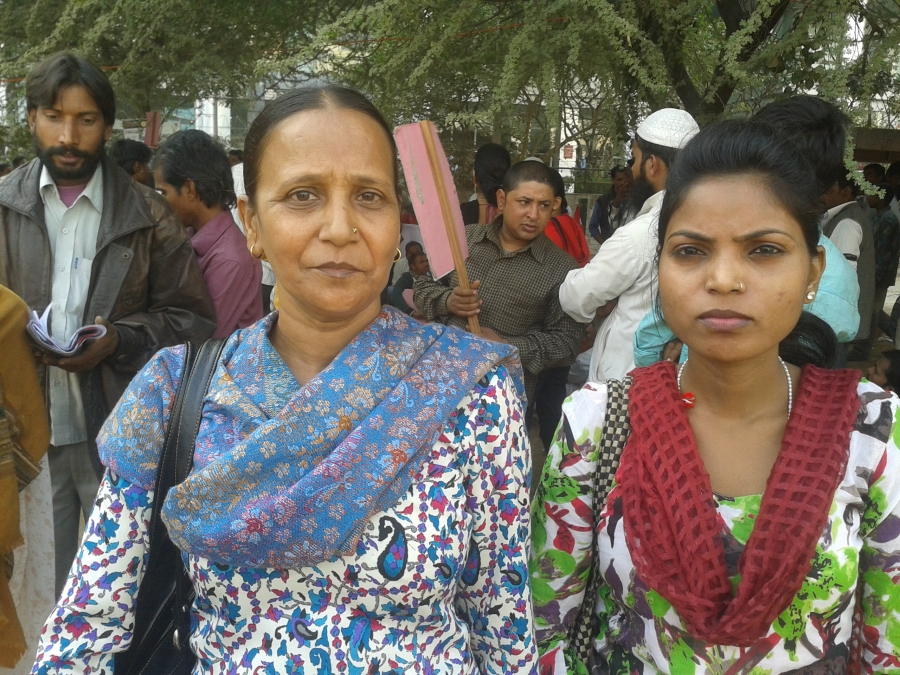 Sudha, a 42 year-old widow (left) has been selling purses at a market in West Delhi. Lately, she says her business has suffered as more and more people are choosing to shop at bigger stores in malls.