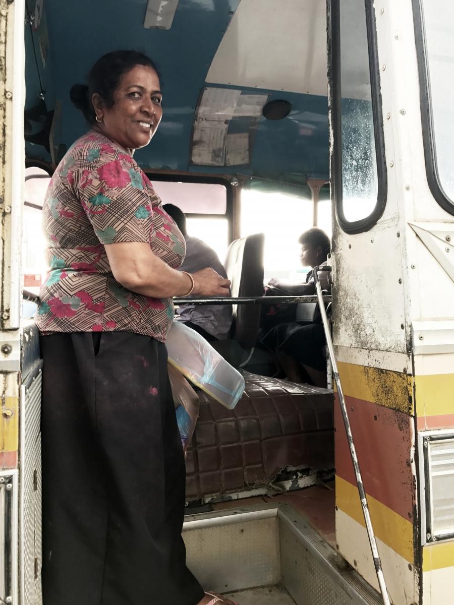 Sunila Wati boards a bus back to her village.